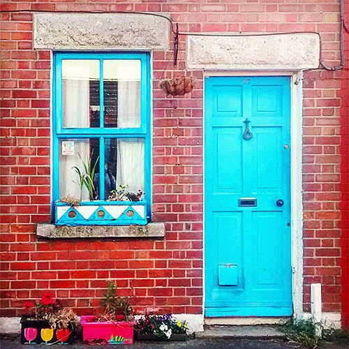 Traditional blue door and window on old house in The Liberties Dublin
